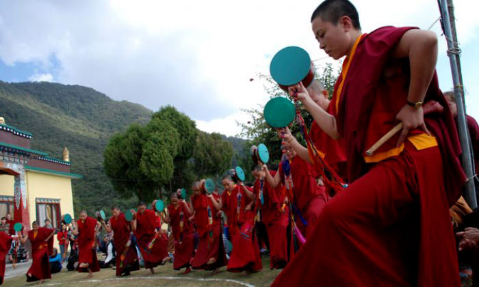 Buddhist nun performing ritual dance in Nagi Gompa in Shivapuri National Park hiking route
