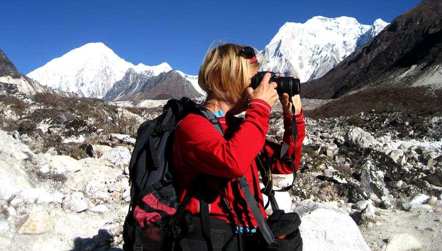 A trekker capturing the nature's beauty in Bimthang trek