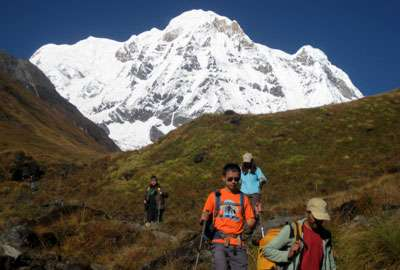 Trekkers and Mt. Annapurna South in Base Camp