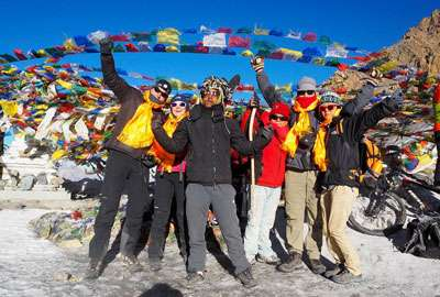 Trekkers pose at Thorong La Pass top