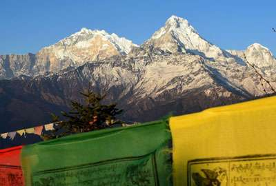 Buddhist Prayers flags and Annapurna at Poon Hill